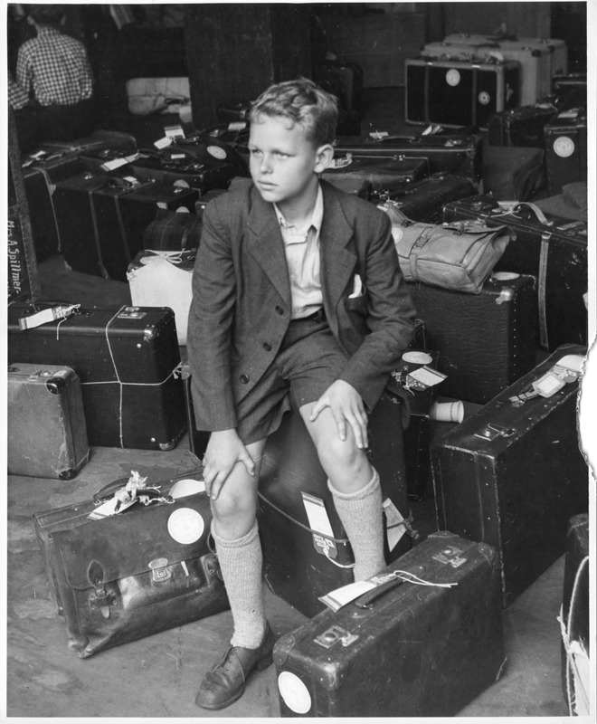 Young DP Sitting with Luggage