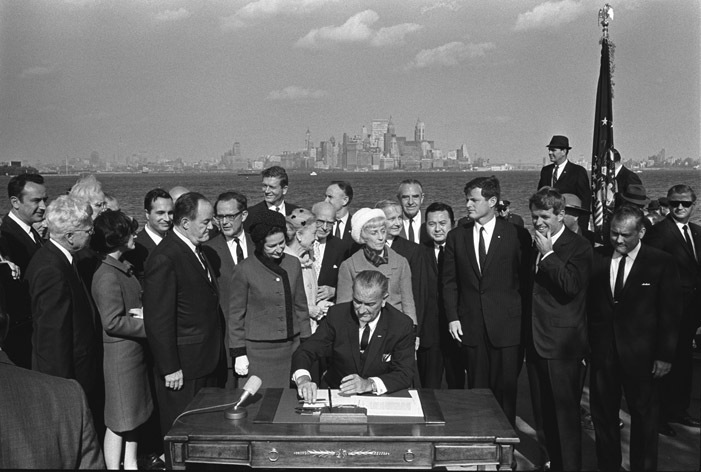 President Lyndon Johnson signing the 1965 Immigration Act at Liberty Island, New York City