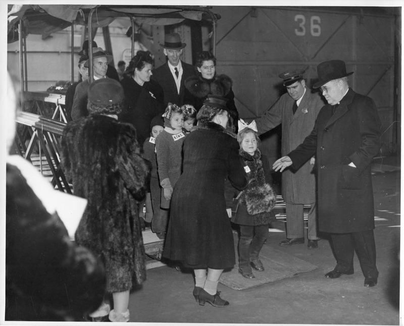 Bishop Mulloy welcomes DP children disembarking at Ellis Island
