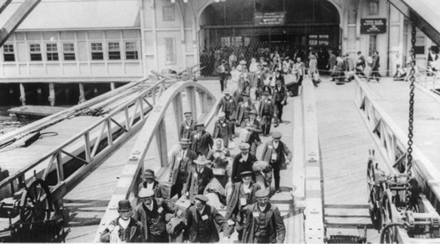 Immigrants arriving at Ellis Island, ca. 1920