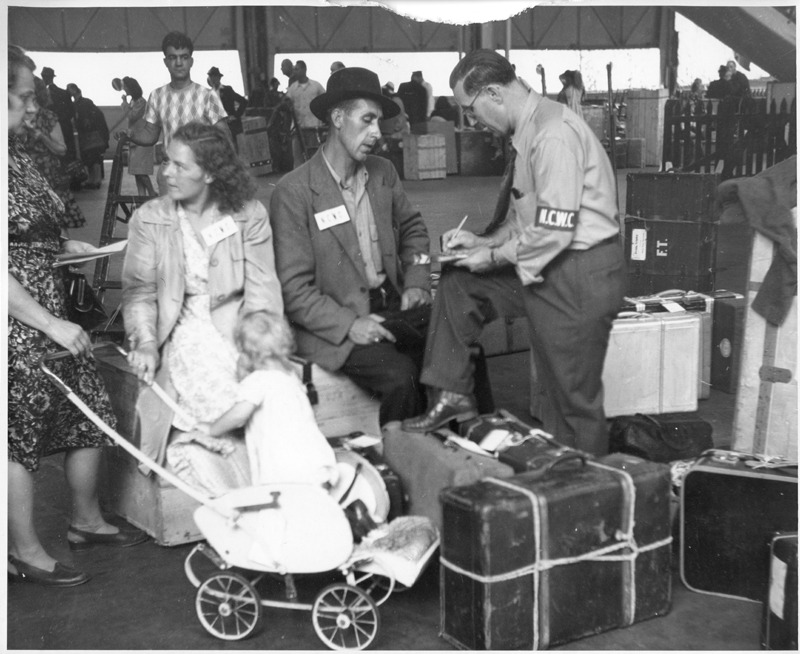 DP Family with a Baby Carriage at Ellis Island