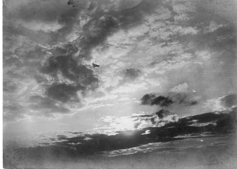 WWI Airplane against Dramatic Clouds