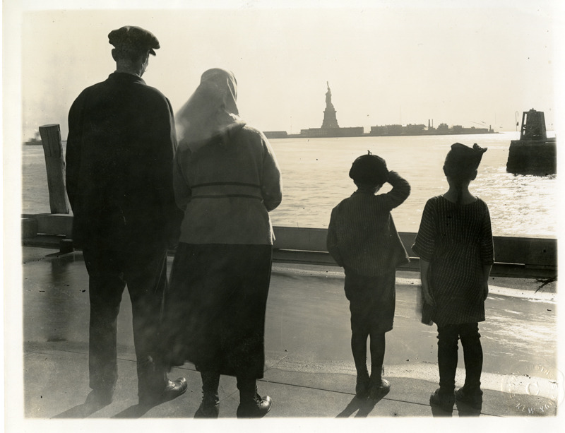 Immigrant Family Views the Statue of Liberty