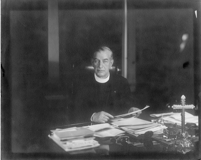 Father John Burke at his desk, 1934