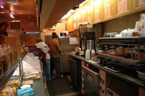 Baristas labor in a Manhattan coffee shop