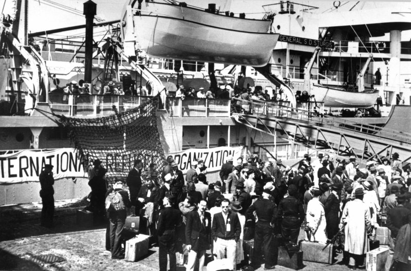 Refugees Board a Boat for America