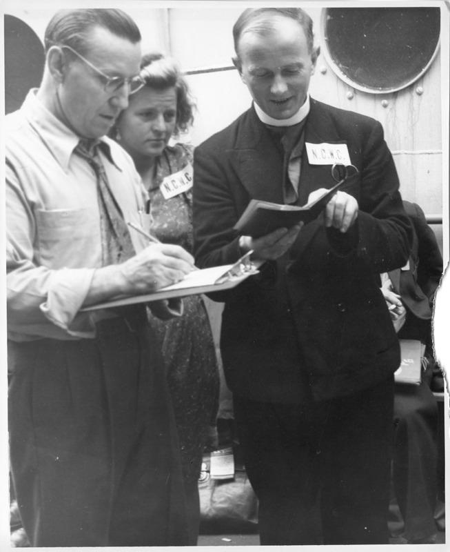 DP priest at Ellis Island