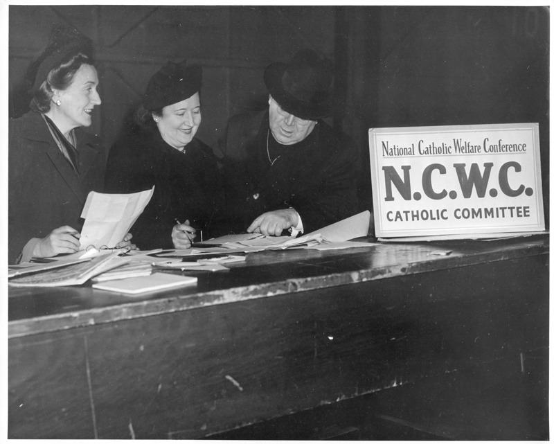 NCWC staffers prepare to greet Displaced Persons at Ellis Island