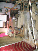 Indian boy with loom